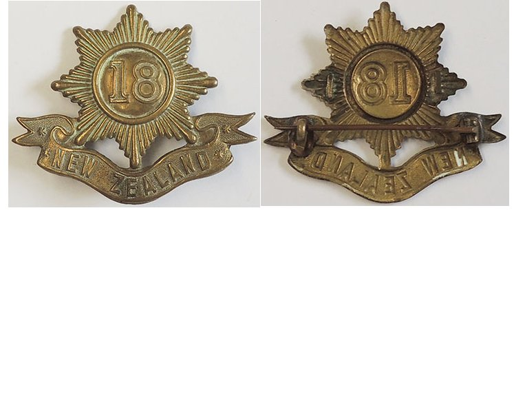 B04/084. 18th REINFORCEMENTS cap badge, brass