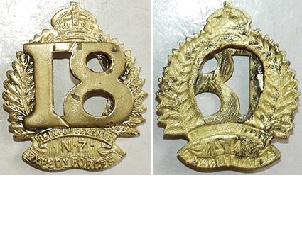 B04/086a. 18th REINFORCEMENTS collar badge, 18 at centre