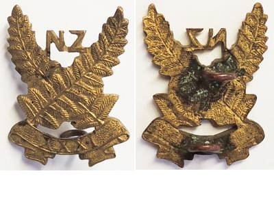 B04/156. 31st REINFORCEMENTS collar badge