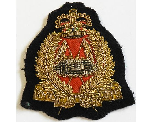 B08/006. ROYAL N.Z. ARMOURED CORPS, gold wire woven hat badge