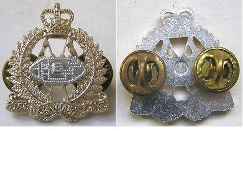 B08/011. ROYAL N.Z. ARMOURED CORPS anodised collar badge QC
