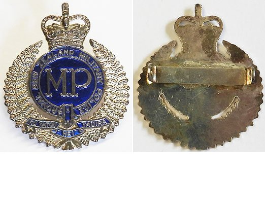 B08/239. ROYAL NZ MILITARY POLICE white metal and blue cap badge