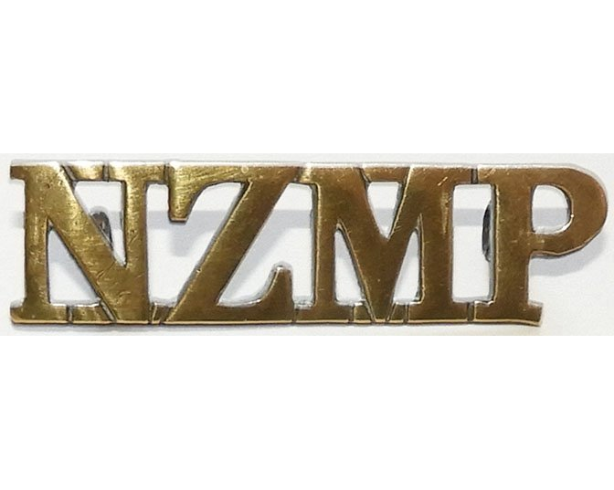 B12/086. NZMP, straight title, (New Zealand Military Police)