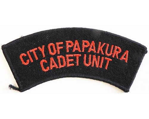 CST003. CITY OF PAPAKURA CADET UNIT, red on black wool