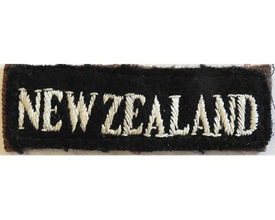 CST007. NEW ZEALAND, white on black straight slip-on, WWII