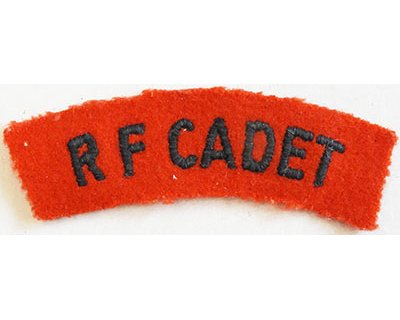 CST026. R F CADET, black woven on red wool, curved