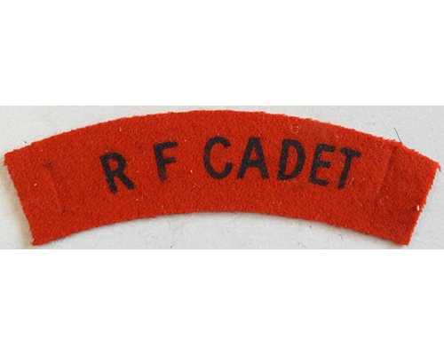 CST027. R F CADET, black printed on red wool, curved