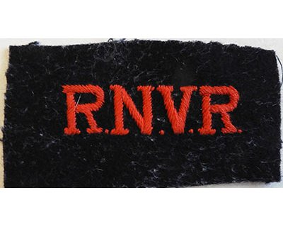 CST063. R.N.V.R. red woven on black wool