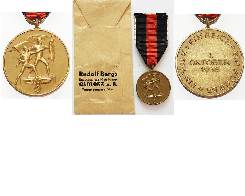 FM0665. COMMEMORATIVE MEDAL OF 1 OCTOBER 1938, with packet