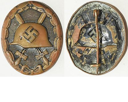 FM0767. WOUND BADGE 1939 in black, brass, missing most paint