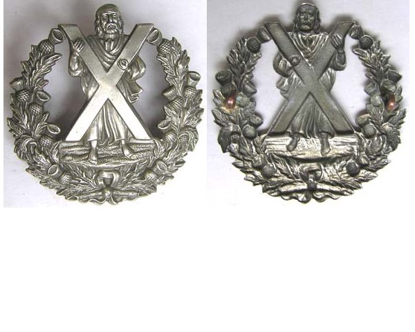 UKB1406. CAMERON HIGHLANDERS w/out scroll white metal cap badge